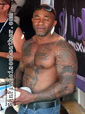 Bodybuilder with Tattoos at Folsom Street Fair 2007 - Click for larger image