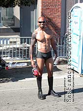 Man in Boots and Rubber Shorts at Folsom Street Fair 2007 - Click for larger image